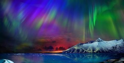 Gorgeous, unreal beautiful night view of the reflection of the northern lights in the water of the ocean and snow-capped mountains. Night Northern Lights is just an amazing sight.