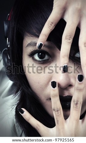 gothic lady with black nails - stock photo