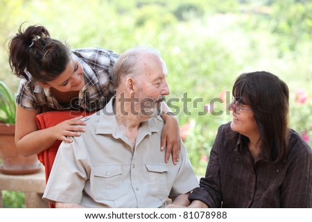 granddaughter and daughter visiting happy smiling grandfather