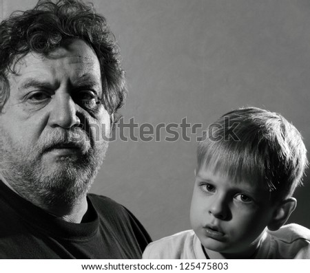 Grandfather and grandson, black and white