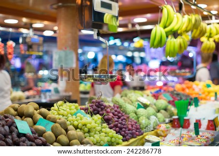 grape and other fruits on european market counter
