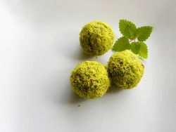 green balls, pistachio dessert on a white background