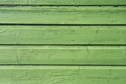 Green painted rare wooden wall background texture.
