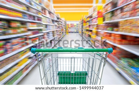 Green shopping cart In the mall And blurred backgrounds