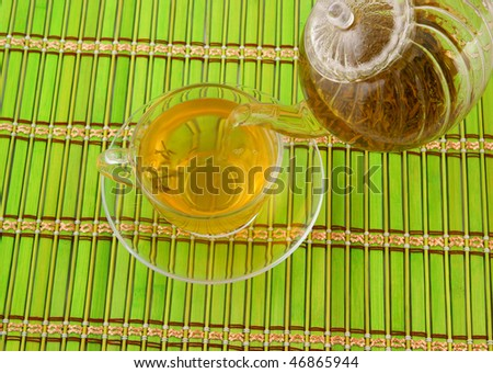 Green tea pouring on bamboo background