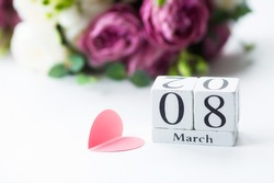 Greeting card for Women's Day on March 8 with a number and a month. Beautiful background of delicate roses. March 8 and the concept of
