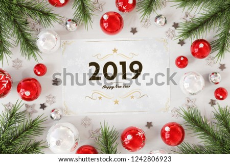 2019 greetings card on white wood with red baubles 3D rendering #1242806923