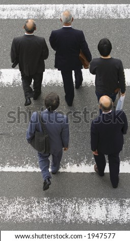 Group of men crossing the street-upper view