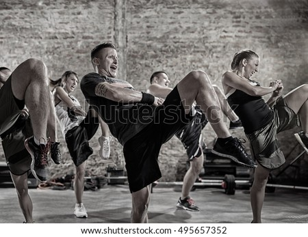 group of people practicing kick, workout class