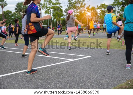 Group people workout exercise with dancing a fitness dance or aerobics in city park