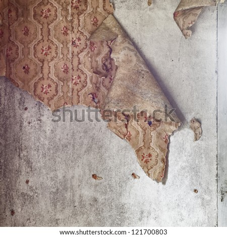 grunge  wall with torn wallpaper background