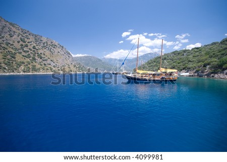 """Gulet"" boat anchored on the turquoise waters of the the Turkish Mediterranean. Wide angle composition."