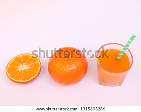 Half orange, orange and orange juice. #1315603286