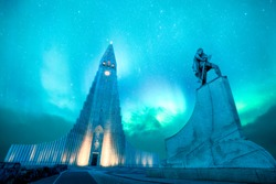 hallgrimskirkja is one of the highest and most famous lutheran church in Reykjavik,Iceland. It is design by Icelandic architecture. There is green northern light and aurora borealis