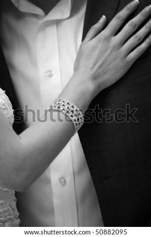 hand of bride on groom