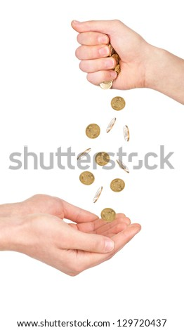 Hand pour down coins into hands of another person - stock photo