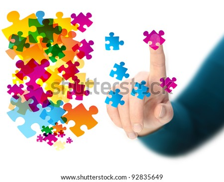 hand touching abstract puzzle piece