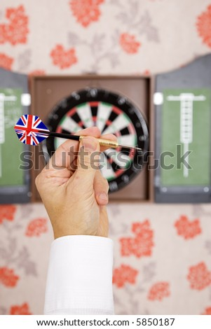 Hand with dart with union jack flag of Britain