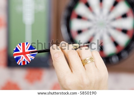 Hand with dart with union jack flag of Britain #5850190