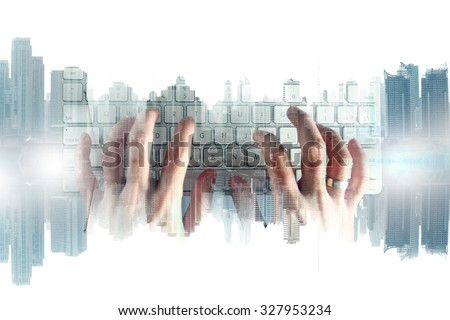 hand with keyboard and city