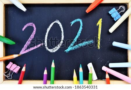 2021 Hand writing chalk on blackboard, Happy new year concept, back to school