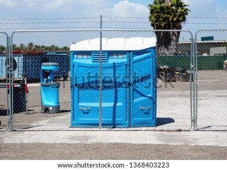Handicap portable  toilet on industrial site                            #1368403223