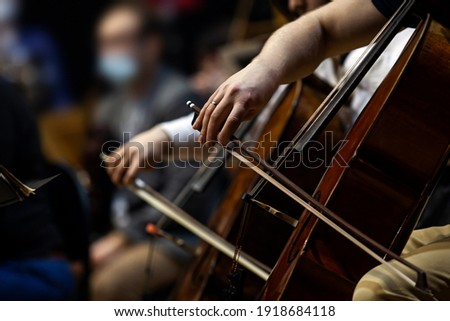 Hands of a musician playing cello in an orchestra Stockfoto ©