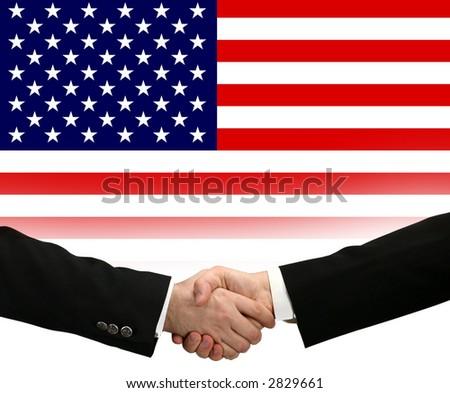handshake - Hand shaking on a american flag background