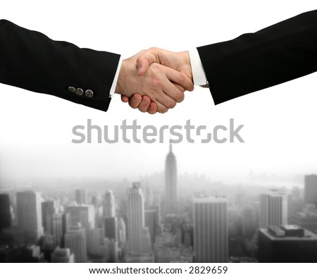 handshake - Hand shaking on a white background