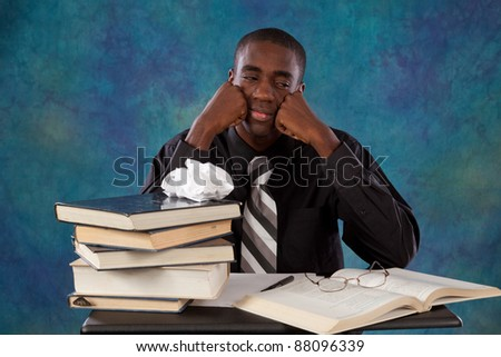 Handsome black man thinking and contemplating what he has read in a book