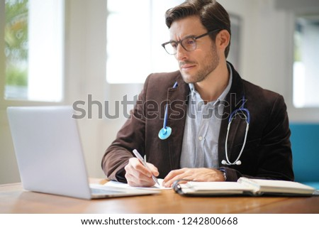 Handsome doctor in office