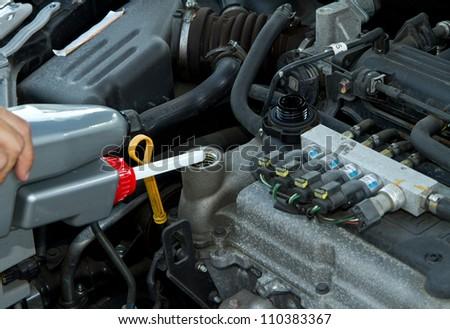Handsome mechanic working in auto repair shop