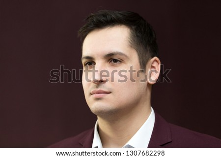 Handsome young man of 25-30 years old in a suit.