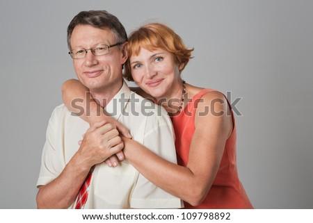 Happy beautiful elderly seniors couple is hugging