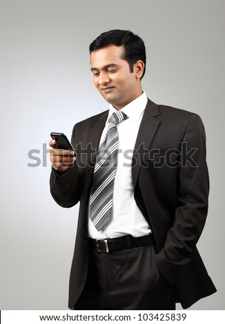 happy business man reading an SMS on smartphone