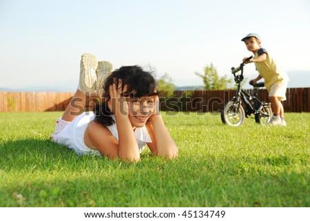 Happy children on beautiful green meadow
