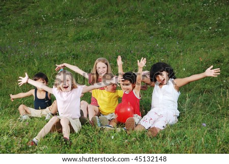 happy children raising hands upwards
