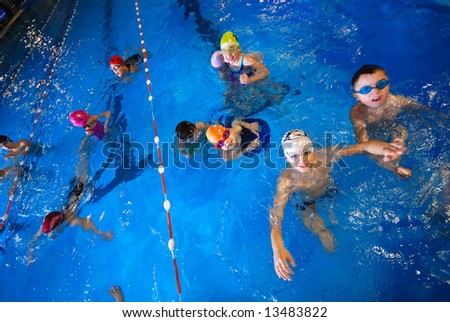 .happy childrens at swimming pool