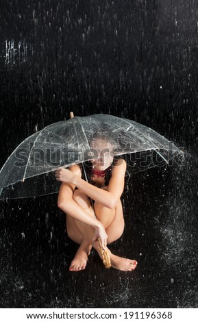 Happy girl with rain and transparent umbrella