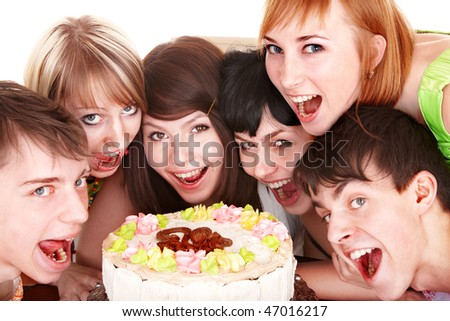 Happy group of young people with cake. Isolated.