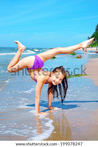 Happy Little Sporty Girl On Beach Stock Photo