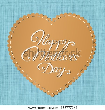 """Happy mother's day"" card. Stylized leather heart-shaped label with embroidered letters against jeans background."