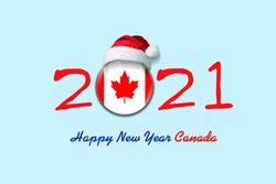 2021. Happy New Year Canada. Flag of Canada in a round badge, and in a Santa hat. Isolated on a light blue background. Design element. Festive background.