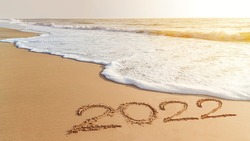 2022 happy New Year coming concept. White waves are lapping towards the shore