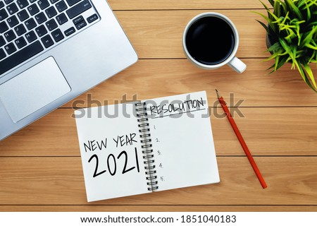 2021 Happy New Year Resolution Goal List - Business office desk with notebook written in handwriting about plan listing of new year goals and resolutions setting. Change and determination concept. Foto d'archivio ©