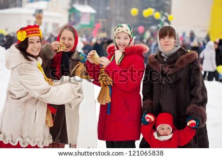 happy people celebrating  Pancake Week at Russia