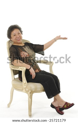 Happy Senior asian woman sitting in chair