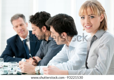 Happy smiling business woman looking at camera with satisfaction at office