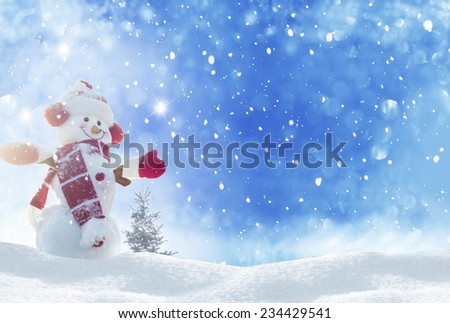 Stock Photo  Happy snowman standing in winter christmas landscape