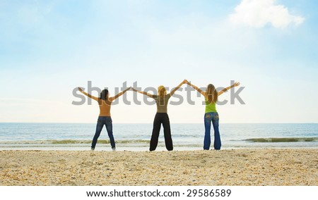 happy teenagers on the beach